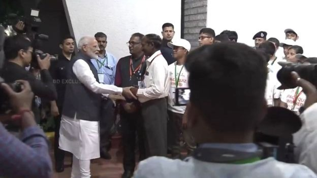 Did Modi see the camera and hug the head of the ISRO 4